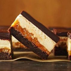 Four-Layer Caramel Crunch Brownies - First comes the brownie layer, then the crunchy caramel layer. Next up is a rich peanut butter nougat topped off with velvety melted chocolate. Put them all together for pure dessert bliss. Just Desserts, Delicious Desserts, Dessert Recipes, Yummy Food, Recipes Dinner, Fun Food, Dessert Healthy, Best Brownie Recipe, Brownie Recipes