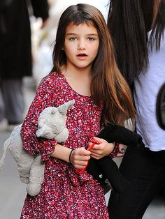 Talk about short bangs! Looks like Suri Cruise has been experimenting with the scissors.