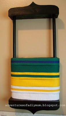 Adventures of a DIY Mom: DIY Karate Belt Holder > Now we're talkin'! Much cheaper to DIY, and not too hard!