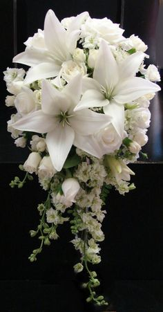 white lilies, white larkspur, and white roses