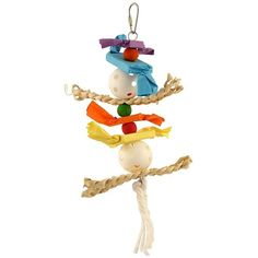 Husker Candy Crunch Parrot Toy - Medium A stack of enticing materials offering a wide choice of activities for your Parrot to explore. This Husker Candy Crunch Parrot Toy has 12 layers of beak-teasingly good materials stacked up and ready to go for your Parrot to chew, preen, rip up, unravel, forage in and much more.  The soft fluffy cotton rope knotted onto the bottom is perfect for your bird to preen on. You can even tie a few more knots in it for your bird to enjoy.