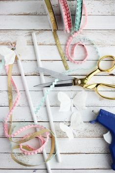 Make these easy Cinderella inspired butterfly wands. All you need is wooden dowels painted white, a variety of ribbons, small butterflies, and a hot glue gun.