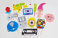 90s Party Decorations, 90s Photo Booth Props. Party like it's 1999! Relive the awesome decade that was the 90s with these decorations. From classic 90s kid toys like Game Boy and Super Soaker to Tamagotchi