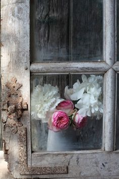 """rustic, vintage, patina, well-worn door/window but the  fresh beautiful flowers, saying: """"It's a new day!"""""""