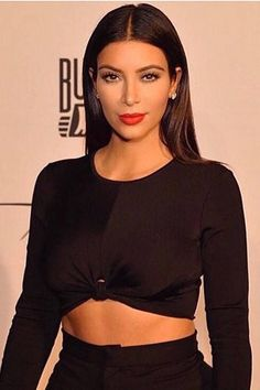 Who: Kim Kardashian What: New Hollywood Glamour How-To: The reality star showed off an understated take on old Hollywood glamour in Dubai last night. Instead of big waves and dark smoky eyes, she went with a sleek center part, long lashes and matte orange-red lipstick. Editor's Pick: Kardashian Beauty Joystick Lip Lacquer in Retro Red, $9, ulta.com. Instagram - HarpersBAZAAR.com