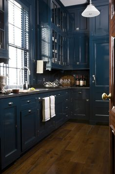 A glossy blue adds sophistication to this kitchen!