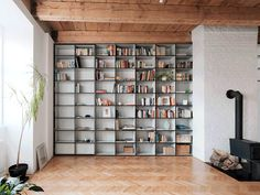 Clever storage helps make most of a 1,000-square-foot apartment - Curbedclockmenumore-arrow : In-wall shelving swings open to reveal more storage space—and entire rooms