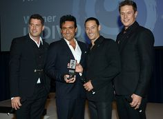 Sebastien Izambard Carlos Marin Urs Buhler and David Miller from Il Divo onstage with their Classical award during the Nordoff Robbins O2 Silver Clef...
