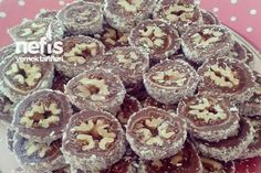 İncirli Cevizli Tatlı - Dried Figs stuffed with walnut, wrapped in chocolate and rolled in coconut! And then sliced.