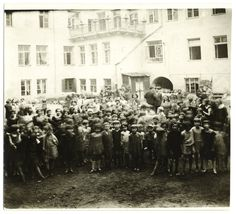 Children posing the courtyard of an orphanage. Vilna, Lithuania 1920s.