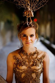 Emma Watson - I love this picture of her, you just kind of have to ignore the strange tree thing on her head! ;)