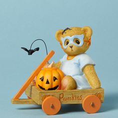 """Item Number: 4040452 Material: Stone Resin Dimensions: 3 in H x 2.25 in W x 3 in L Lane is one of the cutest goblins around, dressed up as """"the masked boo bandit"""" for Halloween. Orange wheels and a fl"""