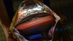 This simple project is both practical and fashionable. Add some interior lights to your purse and never fumble in the dark for your things again. The project makes use of Adafruit's GEMMA Sequin Starter Pack, conductive thread and conductive hook and loop tape. More info at: https://learn.adafruit.com/interior-purse-light