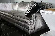 4196 HIGH GLAM SILVER CROC COUCH  Calling all rocker personalities and glamor queens - this couch is perfect for you! Covered in a devilishly fabulous, silver, croc patterned upholstery, it is absolutely gorgeous and a bold statement piece in any living room. A black vinyl trim contrasts brilliantly with the fabulous silver, making this couch the perfect mixture of edginess and glamor.