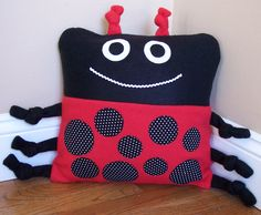 Lady Bug Animal Pillow from 3 Silly Monkeys on Etsy.  14 x14 pillow made from soft fleece.  $20.00