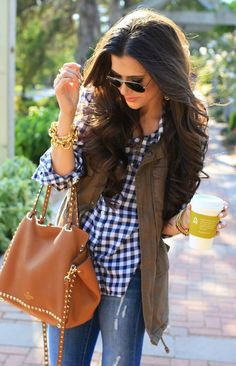 Latest fashion trends: Street style plaid shirt and khaki vest