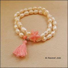 Pulseras de perlas naturales con estrella de mar y pompón rosa.