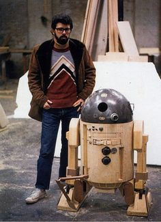George Lucas with the prototype for R2D2, 1975