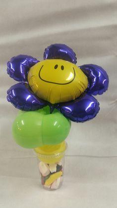 traktatiebeker met paarse bloem