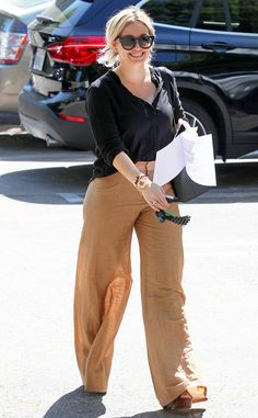 Hilary Duff from The Big Picture: Today's Hot Pics  Happy Hilary! The actress keeps cool in loose flared tan linen pants for an outing in Los Angeles.