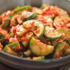 Quick Cucumber Kimchi -- While slowly fermented cabbage and pungent garlic are the ingredients most people associate with kimchi, there are dozens and dozens of other versions of Korea's national dish, featuring all manner of vegetables, such as these quickly pickled cucumbers with just a trace of garlic. #healthy