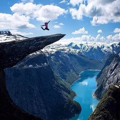 Called The Troll's Tongue by locals, this rock formation in Odda, Norway, is a thrill-seeker's dream. Trolltunga was formed after glacial water froze a chunk of the mountain and caused it to break off way back in the Ice Age. Places Around The World, Oh The Places You'll Go, Places To Travel, Places To Visit, Around The Worlds, Dream Vacations, Vacation Spots, Formations Rocheuses, Viajes