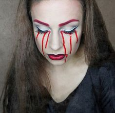 Play around with bloody red tears with this Halloween inspired makeup. Use shades of pale white, dark red and silver to enhance the eyes.