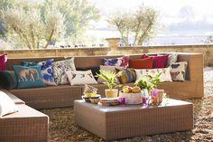 Create a botanical outside living area with Harlequin's Amazilia fabrics.