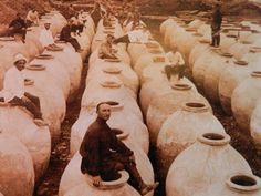 Early 20th century photograph of traditional Georgian clay qvevri (kvevri). The entire wine making process takes place within the qvevri, which is buried in the ground. In 2013, this traditional wine-making method was recognized by UNESCO as part of the Intangible Cultural Heritage of Humanity. Photo courtesy of the Qvevri & Qvevri Wine Museum at the Twins Wine Cellar in Napareuli in Kakheti region