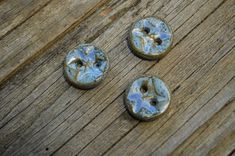 Blue stars, such as Rigel in the Orion constellation, have always held a fascination for me! These blue star buttons were fired with a glaze that breaks to several shades of blue. Price is for three 2 cm buttons. Hand wash or machine wash on gentle with garment turned inside out. Not recommended