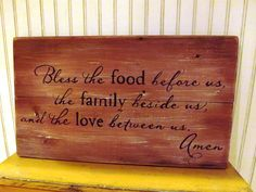 Rustic reclaimed barn wood sign, Bless the food before us, the family beside us and the love between us. amen. $35.00, via Etsy.