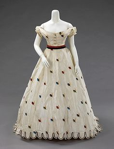 Circa 1875 silk evening ensemble w/short sleeve bodice by Texier St. Engley, French. The choice of fabric and the inclusion of alternate bodices made this ensemble appropriate for both late day and evening wear, via MMA.