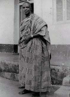 "Africa | Weaver Kwaku Neyeh, wearing a piece of Kente cloth made in 1947.  The name of the pattern is Adjirivirinsu ""Small animal walking in river"".  It is a man's cloth worn on important occasions, for example welcoming a dignitary. 
