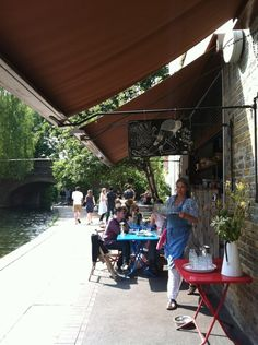 The gorgeous little Towpath Cafe (36 De Beauvoir Crescent) is a lovely spot for a coffee especially when the sun's shining. Very popular though and limited space (and shelter!)