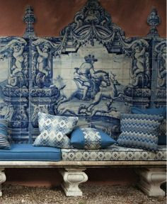 Blue-tiled bench with cushions Handmade tiles can be colour coordinated and customized re. shape, texture, pattern, etc. by ceramic design studios