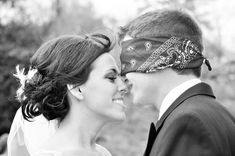 Even if you don't want the groom to see you before the wedding, you can still sneak a kiss and a great photo. Blindfold the groom and have the photographer snap a shot of the pre-wedding kiss. Cute :)