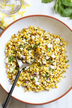 This charred Grilled Corn Salad with Feta is an easy 5-ingredient summer side dish or light lunch. It goes perfect with anything you're grilling!