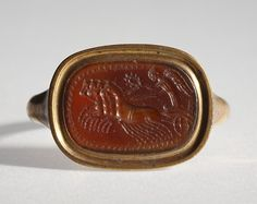 Nike in a chariot drawn by four horses. Graeco-Roman ringstone, 30 BC-200  Cornelian, gold (modern gold ring). 1,0 x 1,3 cm Inventory number: I578