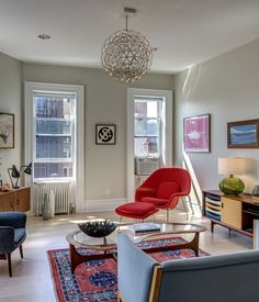 A nice as everything in this room is, a womb chair will always take center stage. That hanging lamp is a runner up though