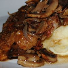 smothered pork chops--6 pork chops with fat trimmed off    8 oz. mushrooms, sliced    1 green pepper    1 pkg. of onion gravy mix    1 tbsp. water    1 15 oz. can tomato sauce  Put pork chops in a baking dish, mix all the other ingredients together, and pour over chops. ----Cover with foil. Bake in a 350-degree oven for an hour and a half.
