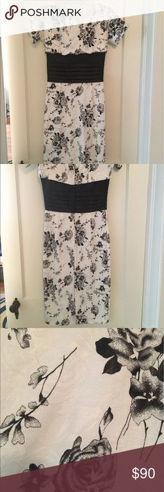 80386c74dd Betty Page wiggle dress Black and white floral wiggle dress. White has  iridescence to it