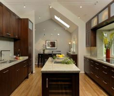 Contemporary Galley Style White kitchen, walnut cabinets,