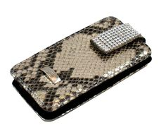 Snake pattern phone bag from Cango & Rinaldi is handmade in Italy. This genuine leather mobile phone bag gives beautiful this to your outfit and excellent protection for your mobile phone. It is decorated with bright Swarovski crystals.