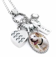 I can customize this beautiful pet cremation urn necklace with your choice of 2 charms from my catalog, this photo shows a paw and angel wings, urn of your choice, the glass charm a quote, name with d