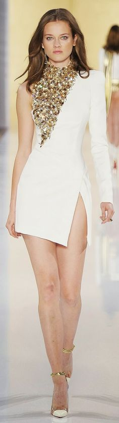 white mini skirt with white shoes and necklace
