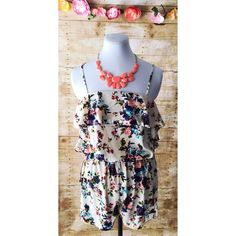LAST 1 LEFT SALE!.   NWOT FLORAL ROMPER Brand new cream/taupe floral romper with spaghetti straps. This is a super stylish addition to a summer wardrobe! Silvergate Shorts