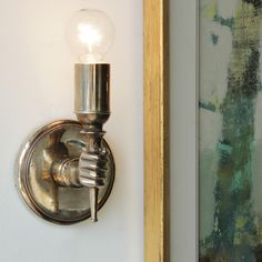 // NK Hand Sconce