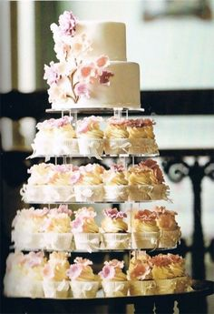 cake for the bride & groom.cupcakes for everyone else. :) I always wanted cupcakes at my wedding! Small Wedding Cakes, Wedding Cakes With Cupcakes, Simple Cupcakes, Wedding Cupcakes Display, 2 Tier Wedding Cakes, Heart Cupcakes, Budget Wedding Cakes, Cupcake Tower Wedding, Valentine Cupcakes