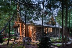 The picturesque mountain cottage or cabin design that follows features a romantic stone and shingle exterior with steeply pitched,  i.e., pointed gables, and a large stone chimney.  A stock plan from Hendricks Architecture in Sandpoint, Idaho, it encompasses only 835 square feet.    However,  its airy floor plan and soaring ceilings with open beams and architectural trusses make it seem larger Two optional loft areas can be built to gain an additional 137-159 square feet.