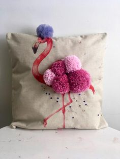 Pink Flamingo Pom Pom Cushion. Queenie is a beautiful Pink Flamingo with a full plumage of hand made Pom Poms and gracing a dove grey tulle crown. This cushion deserves a regal title. The cotton linen cushion has a sprinkling of hand sewn sequins to add that hint of sparkle. Size 45cm X 45cm Wool Pillows, Throw Cushions, Diy Pillows, Pom Pom Cushions, Diy Cushion Covers, Cushion Embroidery, How To Make A Pom Pom, Pom Pom Crafts, Pink Flamingos